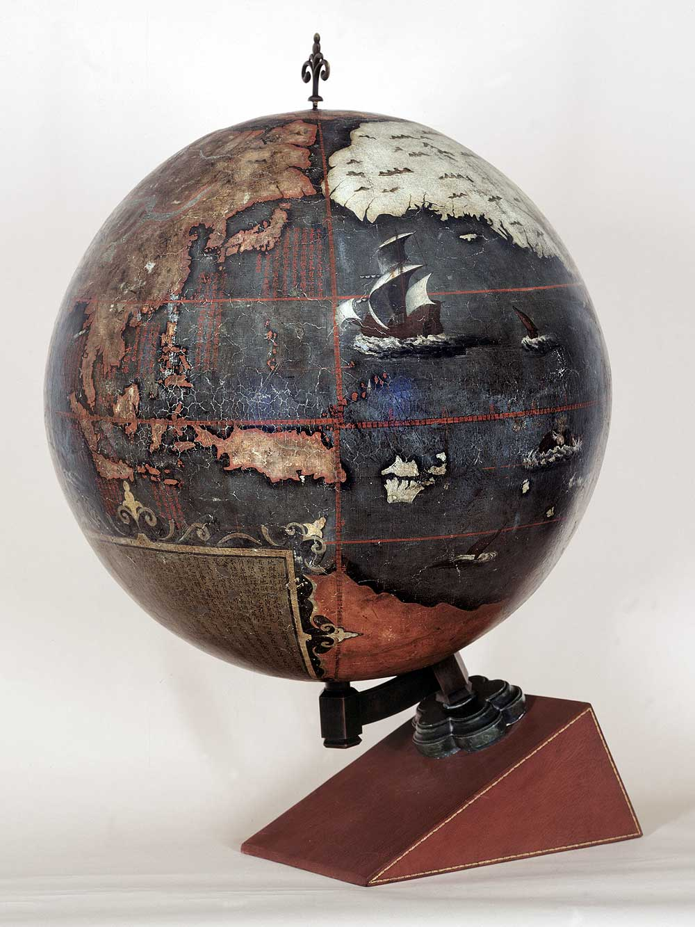 "Terrestrial globe, 1623. China. Lacquer and pigments on wood. British Library, London. Known simply as ""The Chinese Globe,"" this is the oldest extant globe made in China. It was a collaborative work between European Jesuits and Chinese literati. The Chinese text explains the concepts of longitude and latitude, and discusses astronomical observations. It incorporates knowledge about the magnetism of the earth from Chinese sources, which were more advanced on this topic than those in the West. Synthesizing Western and Asian knowledge, this might be regarded as the first ""global globe."""