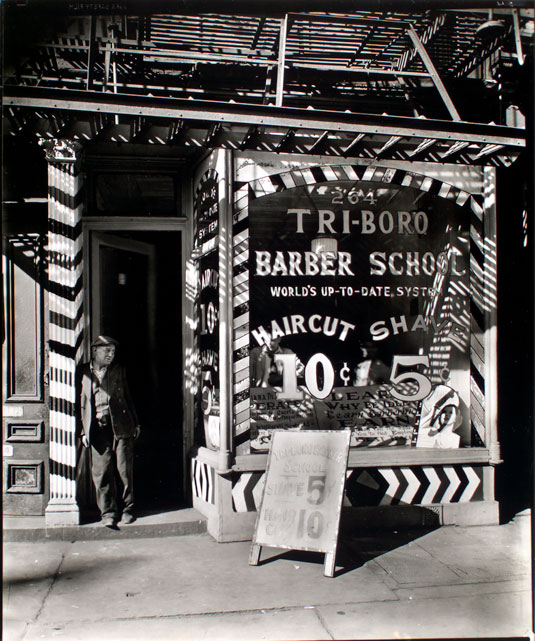 """""""Tri-boro Barber School, 264 Bowery, Manhattan, , 1935-1939, byBerenice Abbott (1898-1991).Photograph; gelatin silver print, matte.The Miriam and Ira D. Wallach Division of Art, Prints and Photographs: Photography Collection, The New York Public Library. New York Public Library Digital Collections."""