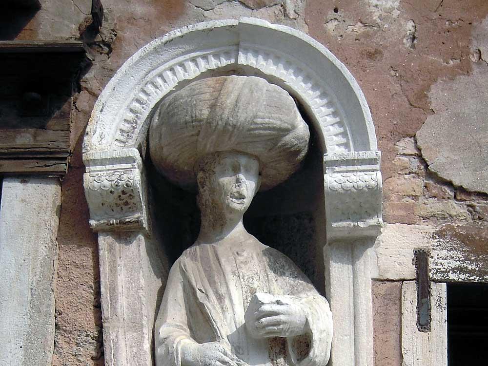 Turbaned figure in exterior wall niche,Campo dei Mori, Venice.
