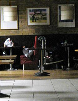 sleep in a restaurant booth at Heathrow airport
